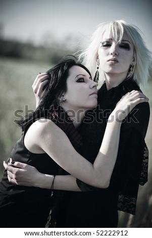 Two goth women portrait. Sadness concept. - stock photo