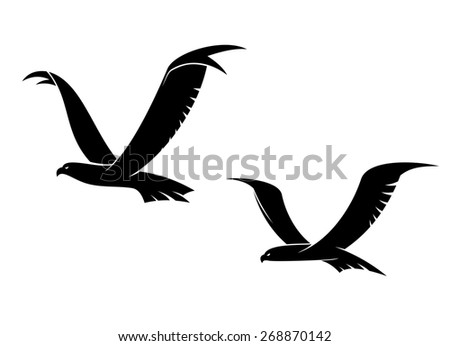Two graceful flying birds in a black silhouette with outspread wings for tattoo or power concept design - stock photo