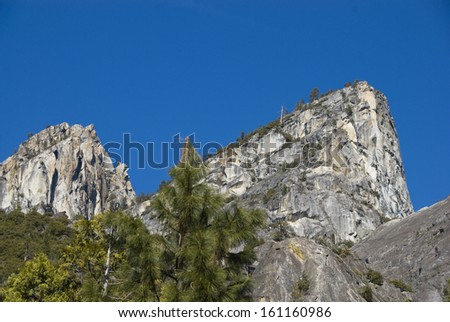 Two granite knobs rise above the lower part of Yosemite Valley - stock photo