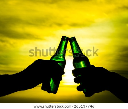 two green bottle of beer / lager cheers - stock photo