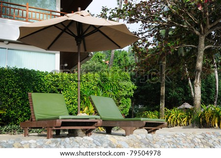 Two green chairs in the garden resort - stock photo
