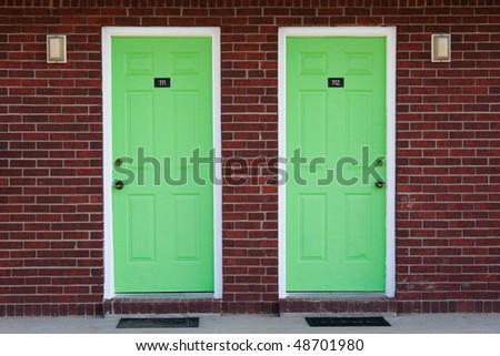 Two green doors - stock photo