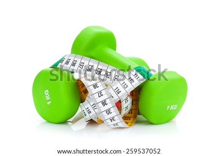 Two green dumbells and tape measure. Fitness and health. Isolated on white background - stock photo