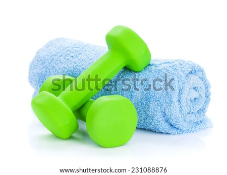 Two green dumbells and towel. Isolated on white background - stock photo