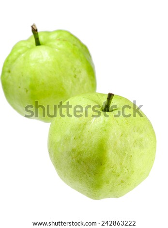 Two green guavas on the  white background - stock photo