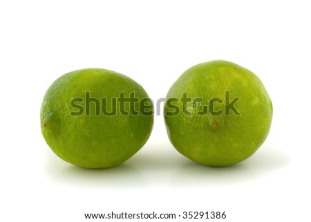 Two green limes isolated on white background - stock photo