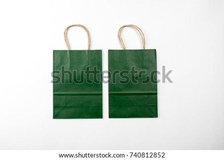 Two green paper bags on a white background top view