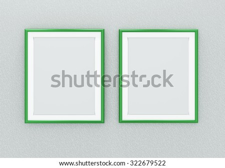Two green picture frames over light grey wall - stock photo