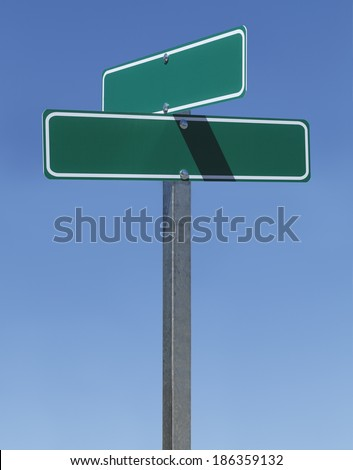 Two Green Street Signs on Metal Pole With Copy Space with Blue Sky. - stock photo