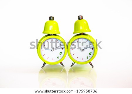two green style alarm clock isolated on white