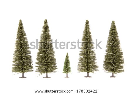 Two green toy fur-trees isolated on white - stock photo