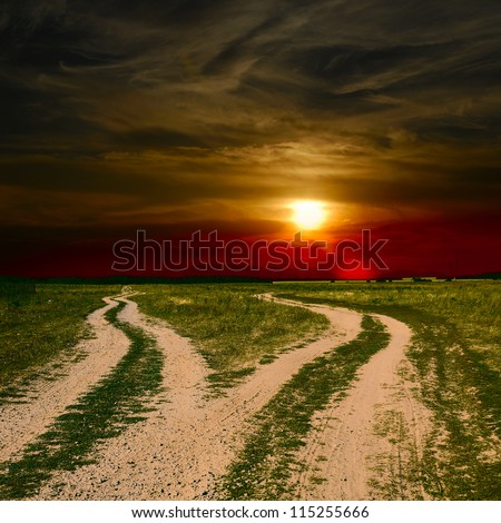 two ground roads at sunset - stock photo