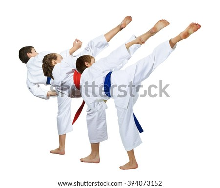 Two guys and a girl doing a high kick - stock photo