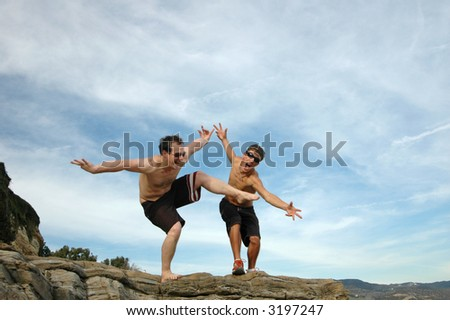 Two guys goofing around at the beach - stock photo