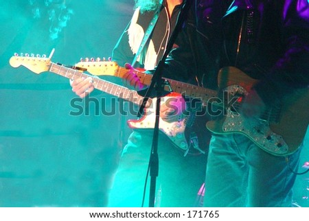 two guys playing guitar in smoky bar - stock photo