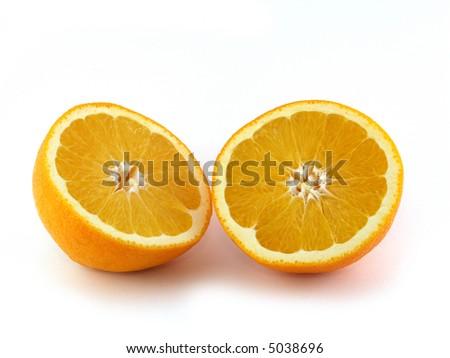 Two halves of orange isolated on white background. - stock photo
