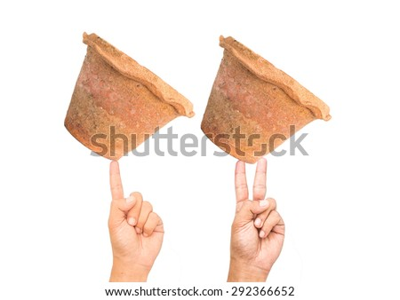 Two hand holding pot isolated on white background - stock photo