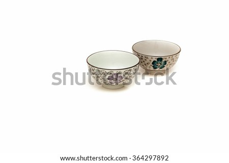 Two hand painted oriental soup bowl on white background. A bowl is a round, open-top container used in many cultures to serve hot and cold food. - stock photo