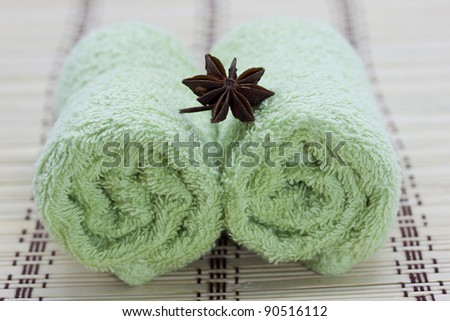 Two hand towels on a bamboo mat - stock photo