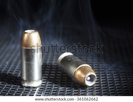 Two handgun cartridges that have hollow point bullets - stock photo
