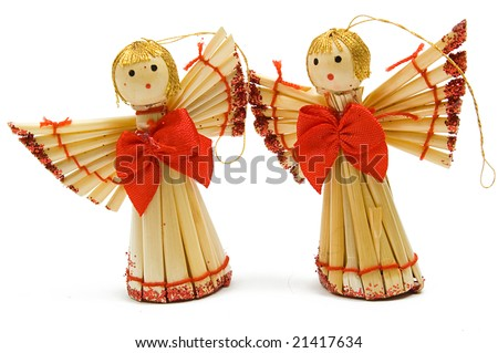 Two handmade christmas decoration angels from straw, traditional russian souvenir, isolated on white - stock photo