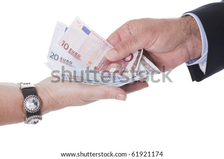 two hands are holding european money
