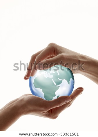 Two hands encircling digitally created glass globe isolated against white - stock photo