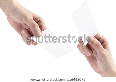 two hands exchanging blank bussiness cards on white background - stock photo