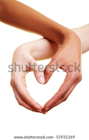 Two hands form a heart shape with their fingers - stock photo
