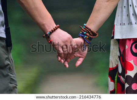 Two hands gently pull together
