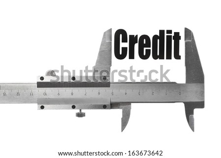 """Two hands holding a caliper measuring the word """"Credit"""". - stock photo"""