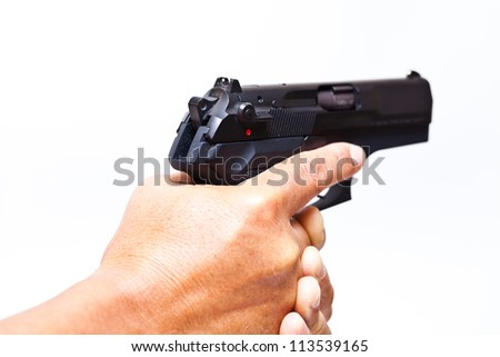 Two hands holding a gun with finger on the trigger on a white background
