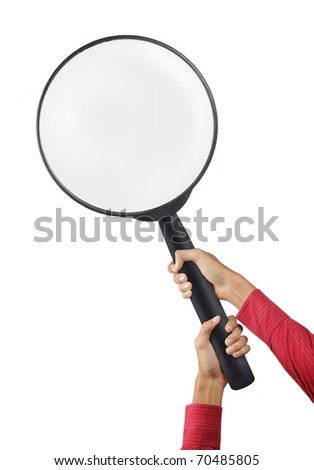 two hands holding big magnifier glass - stock photo