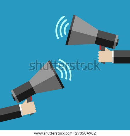 Two hands holding megaphones opposite each other. Communication, promotion, marketing, advertising concept - stock photo