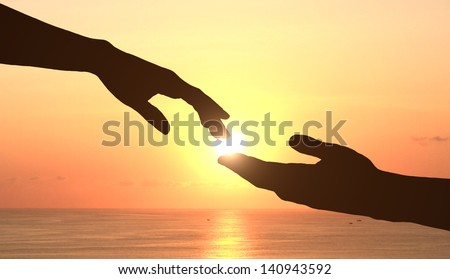 two hands holding puzzle - stock photo