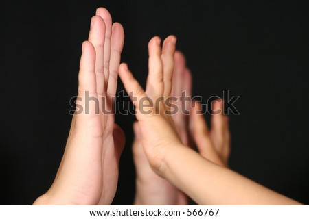 Two hands in motion - stock photo