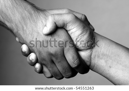 Two hands making hands shake - stock photo
