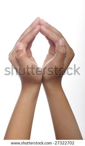 Two hands open in prayer against white background - stock photo