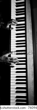 two hands play on piano. Black and white shot. - stock photo