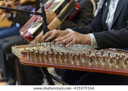 Two Hands Playing Arabian Qanon Musical Instrument - stock photo