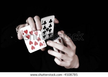 two hands playing cards - stock photo