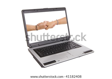 two hands shaking inside a laptop - stock photo