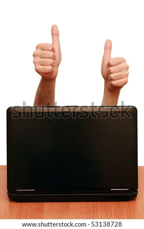 two hands show a gesture of all right, getting out of the notebook - stock photo