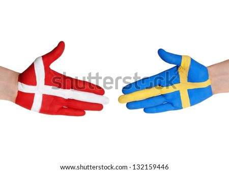 two hands symbolizing denmark and sweden in handshake gesture - stock photo
