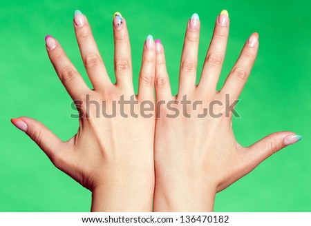 Two hands together with spread fingers - stock photo