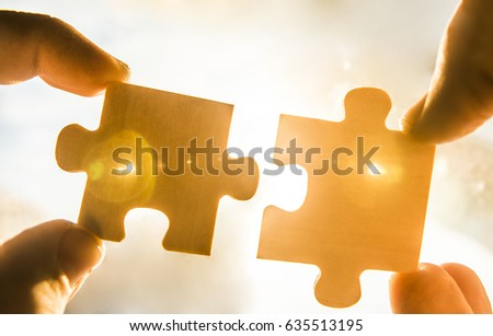 two hands trying connect couple puzzle stock photo edit now