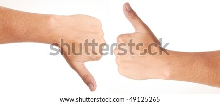 Two hands, with thumbs upward and downward - stock photo