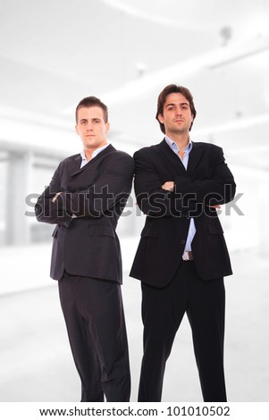 Two Handsome businessmen standing at the office - stock photo