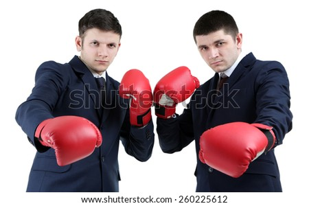 Two handsome businessmen with boxing gloves isolated on white - stock photo