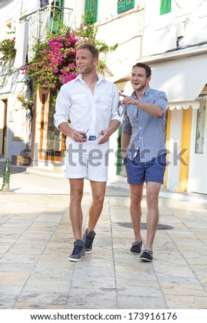 Two handsome tourists walking through the city. - stock photo